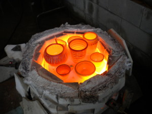 Glowing pots after kiln unit is removed.