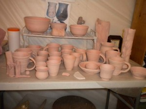 Bisqued pottery pieces waiting to be glazed.