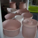 Brown Stoneware and Porcelain, bisqued and ready for glaze.